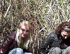 Blonde and redhead outdoor pissers filmed