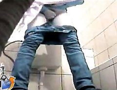 Pee fountains gushing in front of a toilet spy cam
